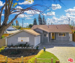 Photo of 21708 Arminta Street, Canoga Park, CA 91304 (MLS # 19471514)