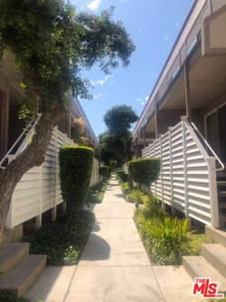 Photo of 18333 Hatteras Street, Unit 124, Tarzana, CA 91356 (MLS # 19499576)