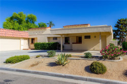 Photo of 40165 Baltusrol Circle, Unit 24-6, Palm Desert, CA 92211 (MLS # IG19194624)