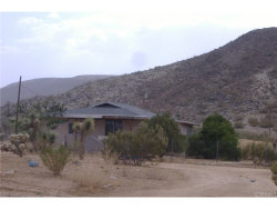 Photo of 2424 Old Woman Springs Road, Yucca Valley, CA 92284 (MLS # JT18175839)