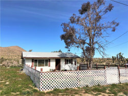 Photo of 58710 Barron Drive, Yucca Valley, CA 92284 (MLS # JT19051428)
