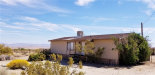 Photo of 7677 Bedouin Avenue, 29 Palms, CA 92277 (MLS # JT19095196)