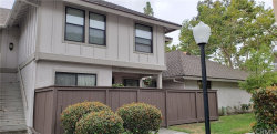 Photo of 9055 Brownstone Circle, Unit 67, Cypress, CA 90630 (MLS # PW19151903)