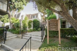 Photo of 18348 Collins Street, Unit C, Tarzana, CA 91356 (MLS # SR18228835)