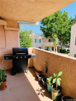 Photo of 21308 Eucalyptus Way, Unit 202, Newhall, CA 91321 (MLS # SR19158526)