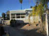 Photo of 26033 Queen Palm Drive, Homeland, CA 92548 (MLS # SW18271193)
