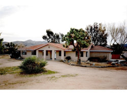 Photo of 8931 Fortuna Avenue, Yucca Valley, CA 92284 (MLS # WS18090086)
