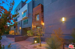 Photo of 11925 Kling Street, Unit 406, Valley Village, CA 91607 (MLS # 18338580)