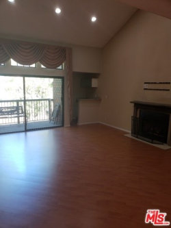 Photo of 18324 Clark Street, Unit 310, Tarzana, CA 91356 (MLS # 18365256)