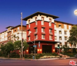 Photo of 6150 Canoga Avenue, Unit 301, Woodland Hills, CA 91367 (MLS # 19533632)