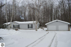 Photo of 7483 NE Starvation Lake Road, Mancelona, MI 49659 (MLS # 1842373)