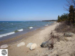 Photo of Lot 9 Eden Woods Court, Eastport, MI 49627 (MLS # 1714964)