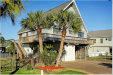Photo of 518 Paradise Drive, Tiki Island, TX 77554 (MLS # 44078535)