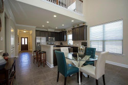Photo of 19 Canterborough PL Place, Tomball, TX 77375 (MLS # 66949624)