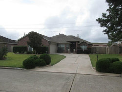 Photo of 18623 Polo Meadow Dr, Humble, TX 77346 (MLS # 94828728)