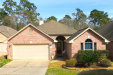 Photo of 10546 Parkside Drive, Willis, TX 77318 (MLS # 32801688)