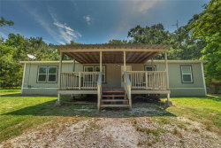 Photo of 744 County Rd 3188, Cleveland, TX 77327 (MLS # 33424918)