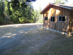 Photo of 56534 TOM SMITH RD, Bandon, OR 97411 (MLS # 18246986)