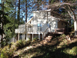 Photo of 70656 MAJESTIC SHORES RD, North Bend, OR 97459 (MLS # 19355504)
