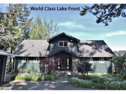 Photo of 88841 RHODODENDRON LN, Florence, OR 97439 (MLS # 19684099)