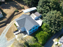 Photo of 62782 FLAGSTAFF RD, Coos Bay, OR 97420 (MLS # 20141839)