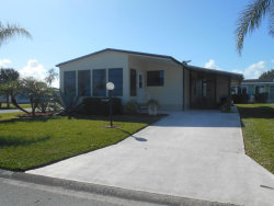 Photo of 701 Bougainvillea Circle, Barefoot Bay, FL 32976 (MLS # 799436)