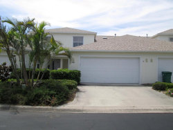 Photo of 216 Thatch Palm Court, Indian Harbour Beach, FL 32937 (MLS # 809931)
