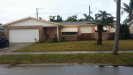 Photo of 248 Harbour Drive, Indian Harbour Beach, FL 32937 (MLS # 818160)