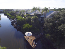 Photo of 539 Island Court, Indian Harbour Beach, FL 32937 (MLS # 819437)