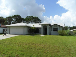 Photo of 1882 NW Cyclone Street, Unit 42, Palm Bay, FL 32907 (MLS # 819723)