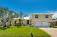Photo of 1248 Seminole Drive, Indian Harbour Beach, FL 32937 (MLS # 825555)