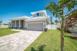 Photo of 125 Enclave Avenue, Indian Harbour Beach, FL 32937 (MLS # 830500)