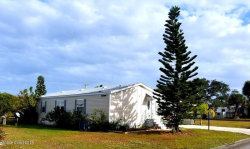 Photo of 416 Plover Drive, Barefoot Bay, FL 32976 (MLS # 835046)