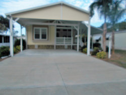 Photo of 1054 Sebastian Road, Barefoot Bay, FL 32976 (MLS # 835226)