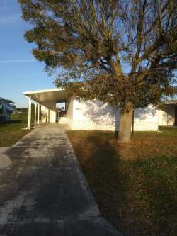 Photo of 1190 Barefoot Circle, Barefoot Bay, FL 32976 (MLS # 835990)