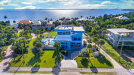 Photo of 7904 S Highway A1a, Melbourne Beach, FL 32951 (MLS # 836005)