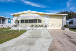 Photo of 1072 Royal Palm Drive, Barefoot Bay, FL 32976 (MLS # 836210)