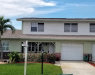 Photo of 606 Desoto Lane, Indian Harbour Beach, FL 32937 (MLS # 837240)