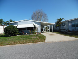 Photo of 911 Periwinkle Circle, Barefoot Bay, FL 32976 (MLS # 837727)