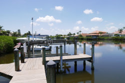 Photo of 503 Island Court, Indian Harbour Beach, FL 32937 (MLS # 849672)
