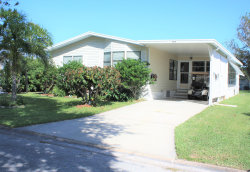 Photo of 608 Wedelia Drive, Barefoot Bay, FL 32976 (MLS # 856636)