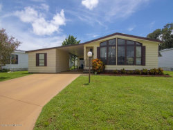 Photo of 825 Periwinkle Circle, Barefoot Bay, FL 32976 (MLS # 856892)