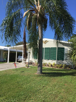 Photo of 1316 Gardenia Drive, Barefoot Bay, FL 32976 (MLS # 857026)