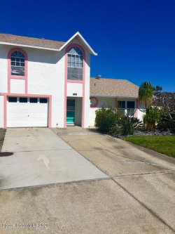 Photo of 303 S Fourth Street, Cocoa Beach, FL 32931 (MLS # 868668)