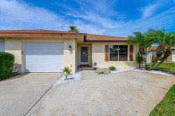 Photo of 77 Anchor Drive, Indian Harbour Beach, FL 32937 (MLS # 868697)