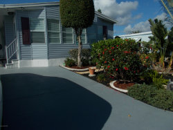 Photo of 959 Frangi Pani Drive, Barefoot Bay, FL 32976 (MLS # 871097)