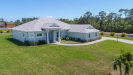 Photo of 852 Whimsical Lane, Malabar, FL 32950 (MLS # 871622)