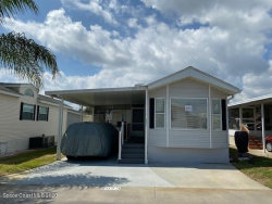 Photo of 2973 Discovery Place, Unit 67, Titusville, FL 32796 (MLS # 871839)