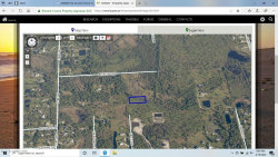 Photo of 000000 No Access Future Grace Lane, Malabar, FL 32950 (MLS # 866613)