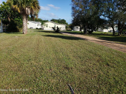 Photo of 414 Plover Drive, Barefoot Bay, FL 32976 (MLS # 892649)